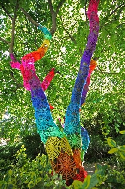 yarn bombing, spider web yarn bombed tree