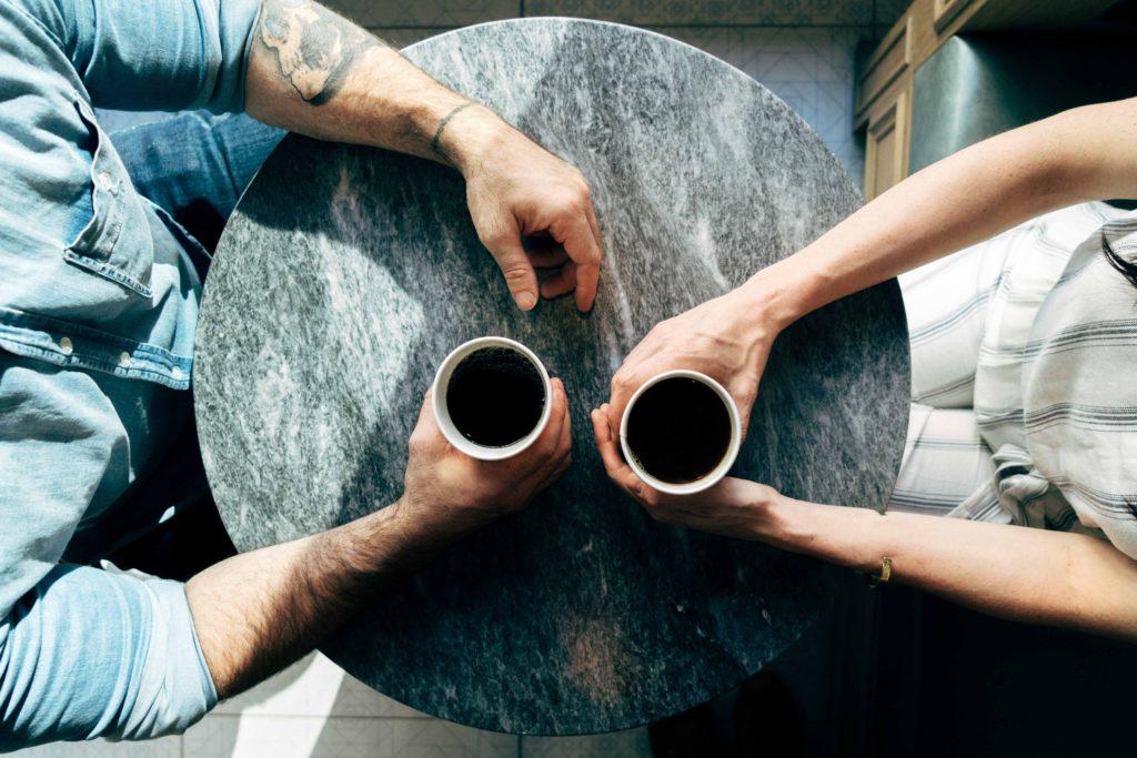 couple setting goals - couple having coffee